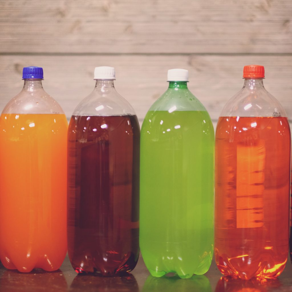 Many carbonated soft drinks contain lots of added sugar